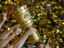 Borussia Dortmund players lift the trophy as they celebrate after victory