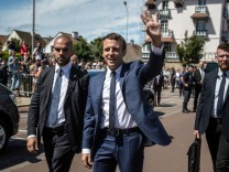 French President Emmanuel Macron leaves polling station after voting in parliamentary elections in Le Touquet