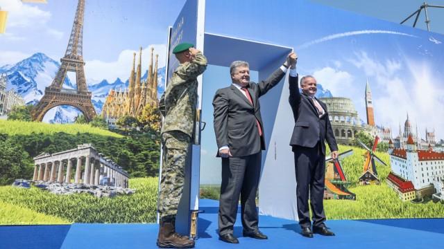 Ukrainian President Poroshenko and Slovak President Kiska attend a ceremony dedicated to a visa-free regime with EU, which comes into force for Ukraine, in Uzhgorod