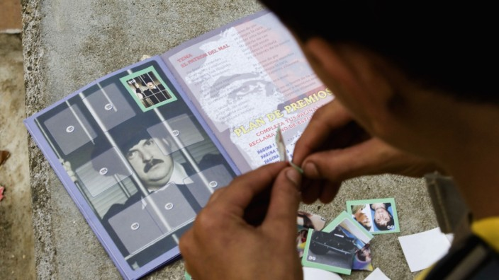 Child pastes stickers of Pablo Escobar in an album that is sold in stores in Medellin