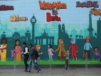 Merkel Visits Foreigners' Registration Agency