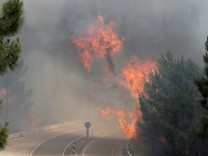Fire and smoke is seen on the IC8 motorway during a forest fire near Pedrogao Grande