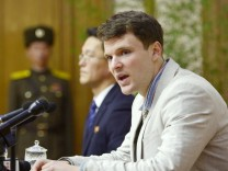 FILE PHOTO - Otto Warmbier attends a new conference in Pyongyang North Korea