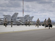 Crew members of Royal Australian Air Force F/A-18F Super Hornets prepare to take-off from RAAF Base Amberley in Queensland