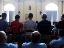 Defendants stand in the court room, ahead of the trial in which they are charged with causing the death of 71 migrants who suffocated in a lorry found beside an Austrian motorway in 2015, in Kecskemet