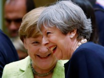 British PM May and German Chancellor Merkel attend a EU leaders summit in Brussels
