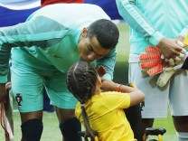 MOSCOW RUSSIA – JUNE 21 2017 Portugal s Cristiano Ronaldo and ten year old wheelchair user Polina; Cristiano Ronaldo Confed Cup 2017