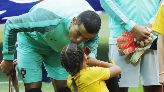 MOSCOW RUSSIA – JUNE 21 2017 Portugal s Cristiano Ronaldo and ten year old wheelchair user Polina; Cristiano Ronaldo Confed Cup 2017