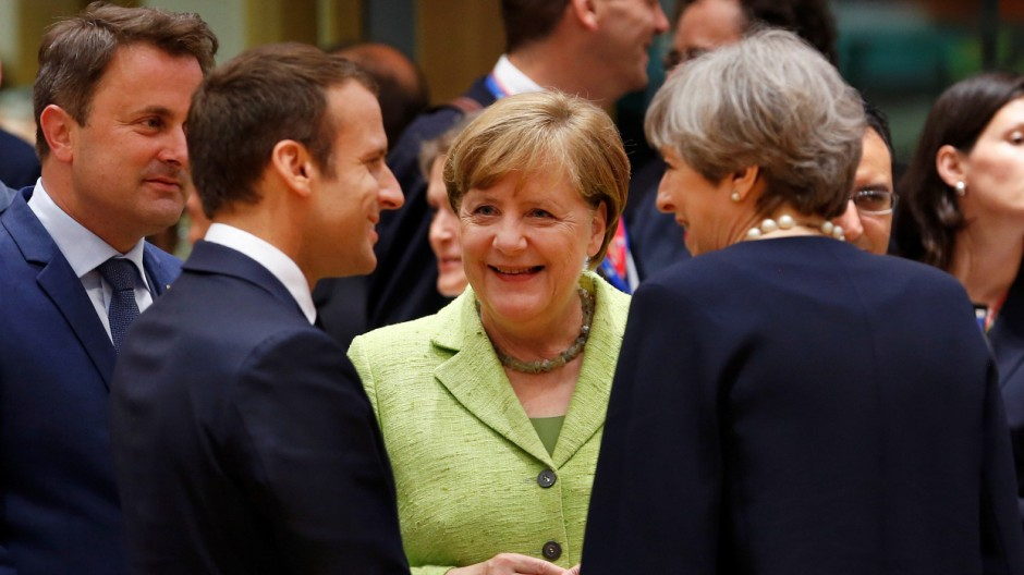 French President Emmanuel Macron, German Chancellor Angela Merkel and British Prime Minister Theresa May attend the EU summit in Brussels