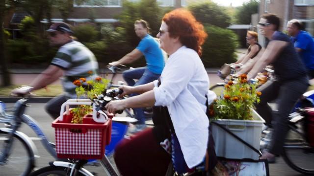 Nijmegen Netherlands 15 06 2017 A large parade cyclists drive through Nijmegen during the Mass Bik