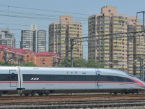 A new model of China's Electric Multiple Unit (EMU) train 'Fuxing' leaves Beijing South Railway Station for Shanghai Hongqiao Railway Station, in Beijing