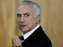 Brazilian President Michel Temer looks on during a credentials presentation ceremony for several new top diplomats at Planalto Palace in Brasilia, Brazil