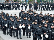 Police forces patrol during a demonstration against a new temporary prison for the G20 Summit in Hamburg