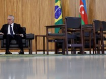 Brazilian President Michel Temer reacts during a credentials-presentation ceremony for several new top diplomats, at Planalto Palace in Brasilia, Brazil