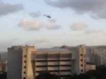 A police helicopter flies over Venezuela's Supreme Court building in Caracas