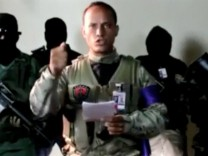 Investigative police pilot Oscar Perez reads a statement from an undisclosed location
