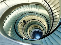 Employees walk down the stairs in the headquarters of world food giant Nestle in Vevey