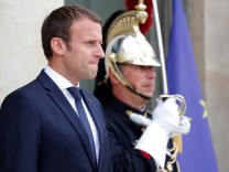 French President Emmanuel Macron waits for a guest at the Elysee Palace in Paris