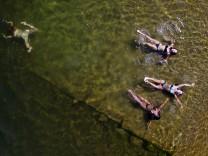 An aerial view shows women swimming in the Yenisei River on a hot summer day outside Krasnoyarsk