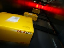 Parcels are pictured in a distribution centre of German postal and logistics group Deutsche Post DHL in Obertshausen