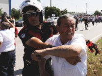 A man scuffles with a police officer as he attends a protest, dubbed 'justice march', against the detention of his Turkey's opposition Republican People's Party (CHP)'s lawmaker Enis Berberoglu, in Duzce