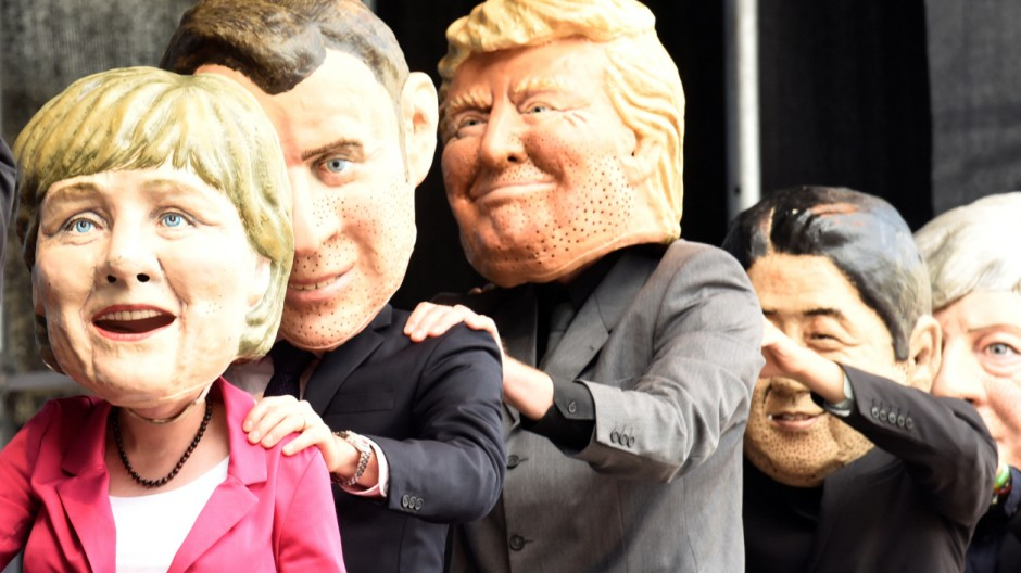 OxfamâÄÖs Big Heads depict G20 leaders take part in protests ahead of the upcoming G20 summit in Hamburg