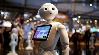 A 'Pepper' humanoid robot, manufactured by SoftBank Group Corp., stands at the Viva Technology conference in Paris