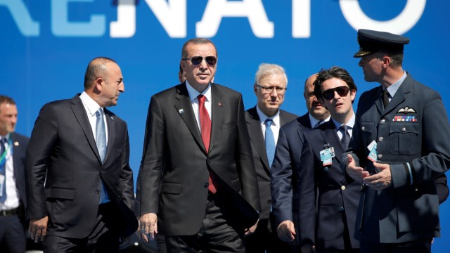 Turkish President Recep Tayyip Erdogan arrives to attend the NATO Summit at their new headquarters in Brussels