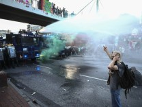 German riot police use water cannons against protesters during the demonstrations during the G20 summit in Hamburg