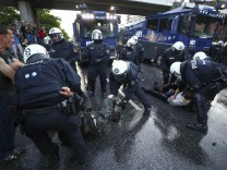 German riot police detain protesters during the demonstrations during the G20 summit in Hamburg