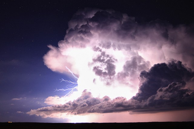 Forked cloud-to-air lightning shoots out the side of a supercell thunderstorm. These bolts are shooting out about 1/2 mile from the parent updraft, Walsenberg, Colorado, USA