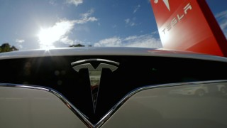 FILE PHOTO - A Tesla Model X car is pictured at a Tesla electric car dealership in Sydney