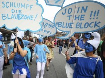 Protesters dressed as smurf characters attend demonstrations at the G20 summit in Hamburg