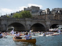 Paris Mayor Anne Hidalgo and the co-president of the Paris bid for the 2024 Olympics Tony Estanguet sail on the Seine river in Paris