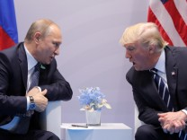 U.S. President Donald Trump speaks with Russian President Vladimir Putin during their bilateral meeting at the G20 summit in Hamburg