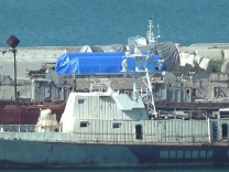 A still image taken from a video footage shows blue tarpaulins covering equipment at the port of Feodosia