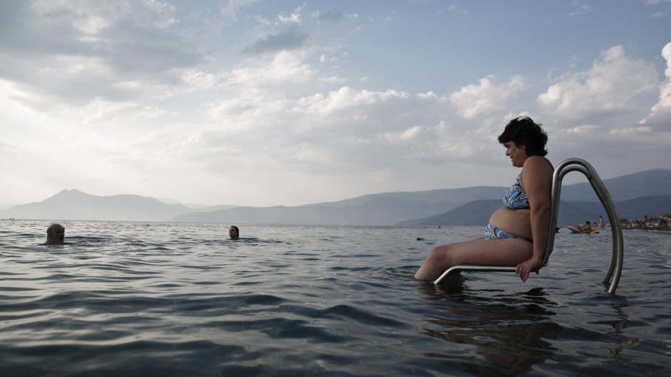 Kastrioti, who suffers from multiple sclerosis, enters the sea with a 'Seatrac' at a beach in Alepochori