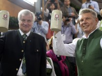 Newly elected mayor of Munich Reiter and Bavarian Prime Minister Seehofer toast with beer after  tapping of first barrel during opening ceremony for 181st Oktoberfest in Munich