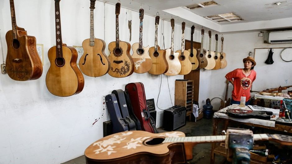 Master Balinese Woodworker Hand Carves High-End Guitars