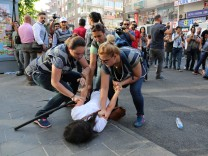 Police officers detain a demonstrator during a protest against the dismissal of civil servants following a post-coup emergency decree, in the Kurdish-dominated southeastern city of Diyarbakir