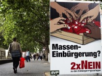 A woman passes an anti-immigrant campaign poster in Zurich
