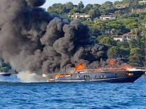 A luxury yacht burns near Pampelonne beach in St Tropez