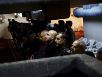 Muslims living in Greece attend Friday prayers at the Masjid Al-Salam makeshift mosque in Athens