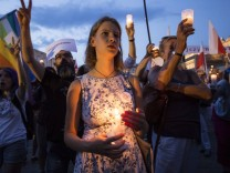 July 22 2017 Poland Anti government protesters gathering in Main Square in Krakow raise candl