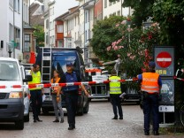 Swiss police officers stand at a crime scene in Schaffhausen