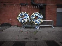 Wreaths are pictured at the site where two uniformed officers were ambushed by a gunman, during Martin Luther King Day activities in the Brooklyn borough of New York