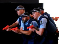 Australian police officers participate in a training scenario called an 'Armed Offender/Emergency Exercise' held at an international passenger terminal located on Sydney Harbour in Australia