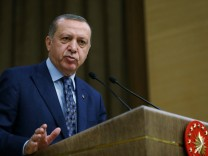Turkish President Erdogan addresses academics during a meeting at the Presidential Palace in Ankara