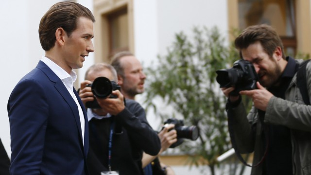 Austria's Foreign Minister and designated new leader of the OeVP Kurz leaves  a news conference in Vienna