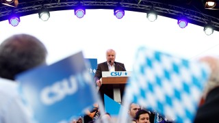 Bavarian state premier and head of the CSU Seehofer gives a speech during the start of a CSU election campaign rally in Munich